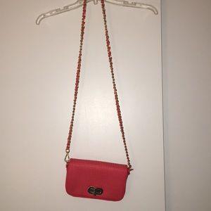 Orange purse with chain strap